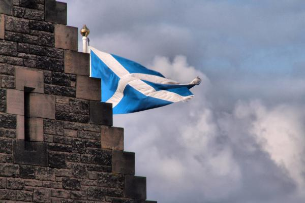 An image of the Scotland flag behind a building