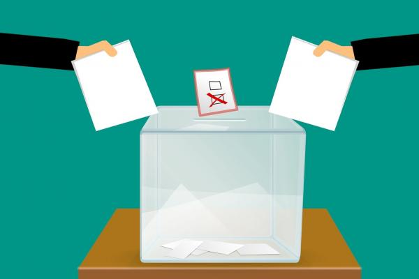 Image of ballot box with votes